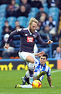 Fernando Forestieri of Sheffield Wednesday slides in on Johnny Russell of Derby County during the Sky Bet Championship match at Hillsborough, Sheffield<br /> Picture by Graham Crowther/Focus Images Ltd +44 7763 140036<br /> 06/12/2015