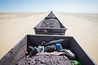 Train hopping on an iron ore train in search of surf in Mauritania. Africa