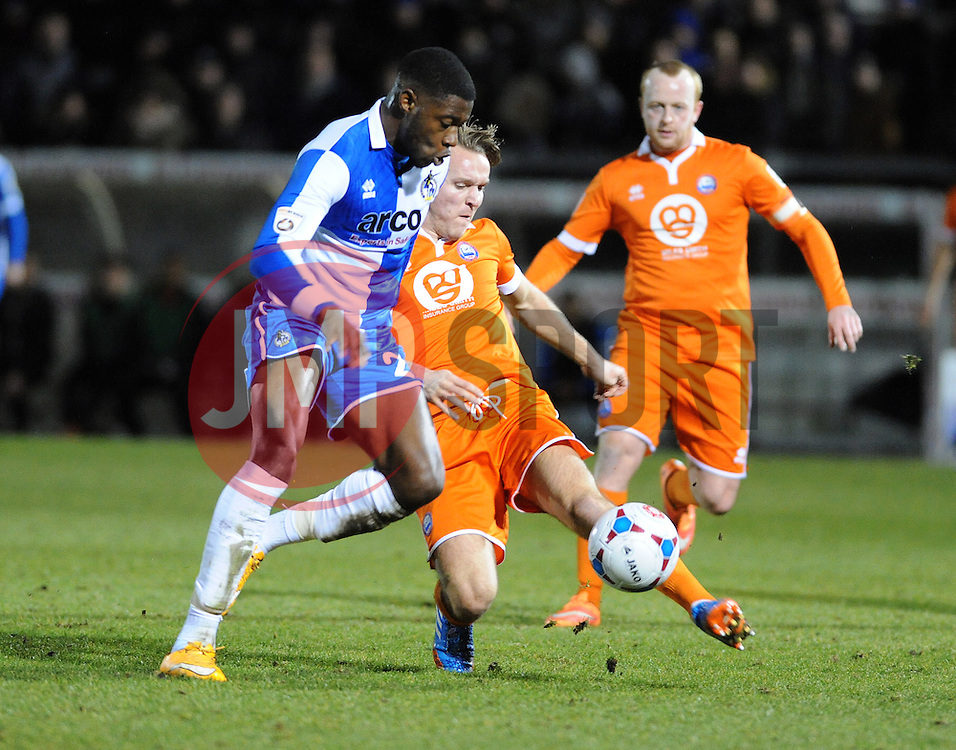 Braintree Town's Chez Isaac clears from Bristol Rovers' Nathan Blissett  - Photo mandatory by-line: Neil Brookman/JMP - Mobile: 07966 386802 - 24/02/2015 - SPORT - Football - Bristol - Memorial Stadium - Bristol Rovers v Braintree - Vanarama Football Conference