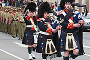 Queensland Police Pipe Band marching in 2014 ANZAC day parade - Hobart <br />
