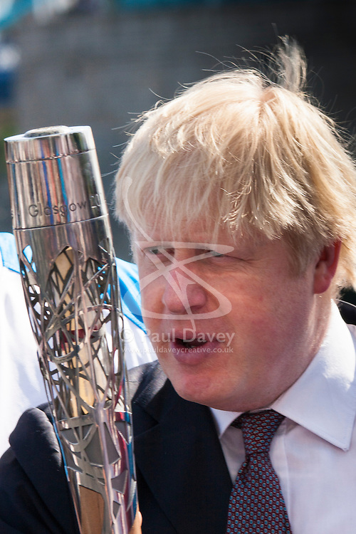 London, June 6th 2014. Mayor of London Boris Johnson with the Commonwealth Games Queen's Baton as he welcomes the relay to London.