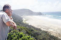Man and Daughter Looking out at Ocean