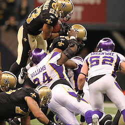 Jan 24, 2010; New Orleans, LA, USA; New Orleans Saints running back Pierre Thomas (23) leaps the pile for a first down to continue a drive against the Minnesota Vikings during overtime of the 2010 NFC Championship game at the Louisiana Superdome. Mandatory Credit: Derick E. Hingle-US PRESSWIRE