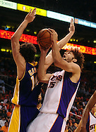May 25, 2010; Phoenix, AZ, USA; Phoenix Suns center Robin Lopez (15) puts up a shot against Los Angeles Lakers forward Pau Gasol (16) during the second quarter in game four of the western conference finals in the 2010 NBA Playoffs at US Airways Center.  Mandatory Credit: Jennifer Stewart-US PRESSWIRE
