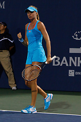 July 27, 2011; Stanford, CA, USA;  Daniela Hantuchova (SVK) celebrates after a point against Maria Sharapova (RUS), not pictured, during the second round of the Bank of the West Classic women's tennis tournament at the Taube Family Tennis Stadium. Sharapova defeated Hantuchova 6-2, 2-6, 6-4.