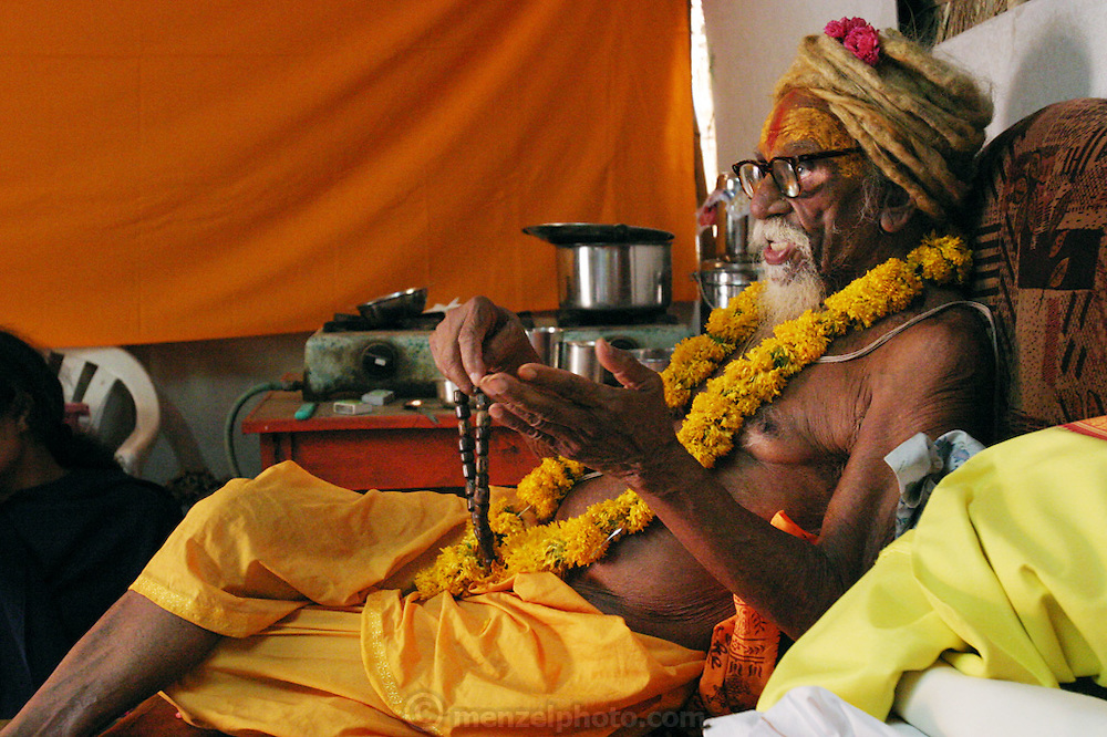 A holy man at the Kumbh Mela Festival, Ujjain, Madhya Pradesh, India claims to only drink one glass of milk per day and be 140 years old. The Kumbh Mela festival is a sacred Hindu pilgrimage held 4 times every 12 years, cycling between the cities of Allahabad, Nasik, Ujjain and Hardiwar. Kumbh Mela is one of the largest religious festivals on earth, attracting millions from all over India and the world. Past Melas have attracted up to 70 million visitors.