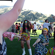 Concert goers dressed in 70's costume, dancing during the Creedence Clearwater Revisited concert at the Queenstown Events Centre, Queenstown, Otago, New Zealand. 5th February 2012. Photo Tim Clayton