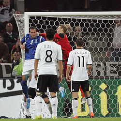 07.09.2010,  Rhein Energie Stadion, Koeln, GER, EM-Qualifikation, Deutschland vs. Aserbaidschan, im Bild: Manuel Neuer (Deutschland #1, Schalke) kommt zu spaet gegen Rail Malikov (Aserbaidschan #2). Mesut Oezil (Deutschland #8, Madrid) und Miroslav Klose (Deutschland #11, Muenchen) schauen zu  EXPA Pictures © 2010, PhotoCredit: EXPA/ nph/  Mueller+++++ ATTENTION - OUT OF GER +++++