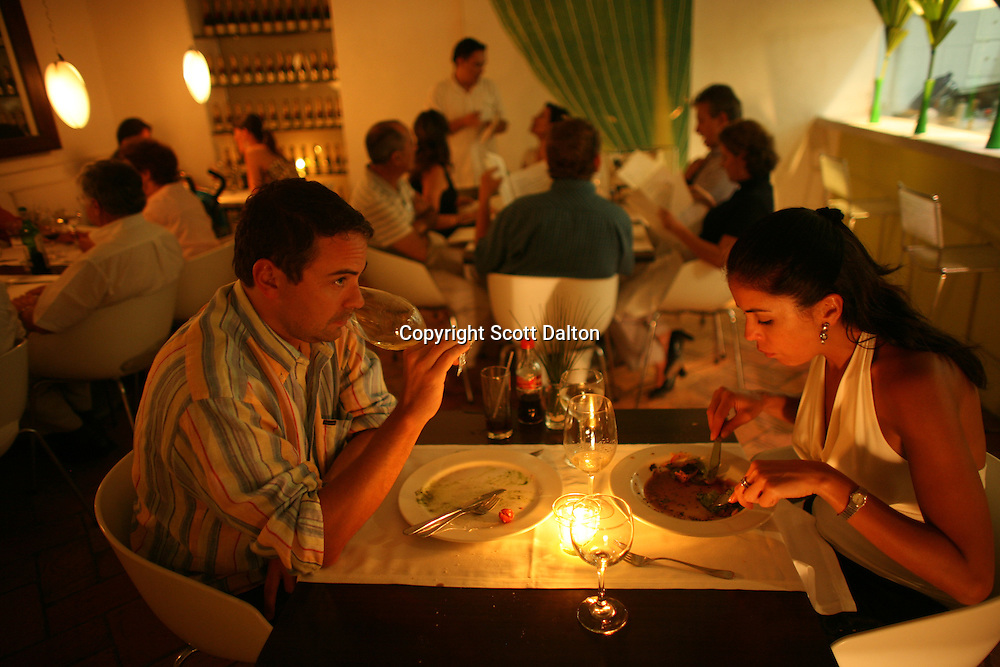 A couple finishes their meal in 8-18, a popular restaurant in Cartagena's old city, on Friday, August 22, 2008. (Photo/Scott Dalton).