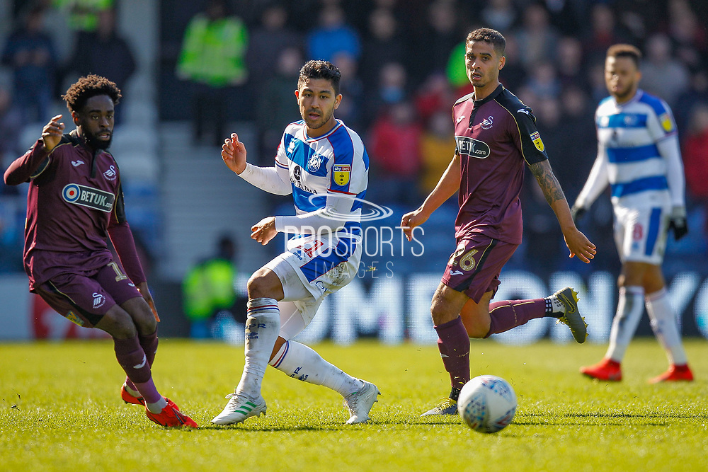 Swansea City midfielder Nathan Dyer (12), Queens Park Rangers midfielder Massimo Luongo (21), Swansea City defender Kyle Naughton (26), during the EFL Sky Bet Championship match between Queens Park Rangers and Swansea City at the Loftus Road Stadium, London, England on 13 April 2019.