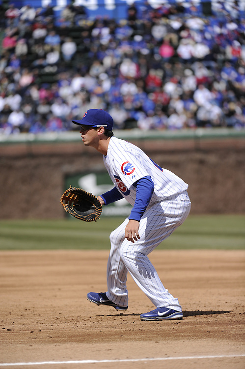CHICAGO - APRIL  05:  Tyler Colvin #21 of the Chicago Cubs fields against the Arizona Diamondbacks on April 5, 2011 at Wrigley Field in Chicago, Illinois.  The Cubs defeated the Diamondbacks 6-5.  (Photo by Ron Vesely) Subject: Tyler Colvin