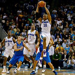 November 17, 2010; New Orleans, LA, USA; New Orleans Hornets power forward David West (30) picks off the in bounds pass in the final seconds of a win over the Dallas Mavericks at the New Orleans Arena. The Hornets defeated the Mavericks 99-97. Mandatory Credit: Derick E. Hingle