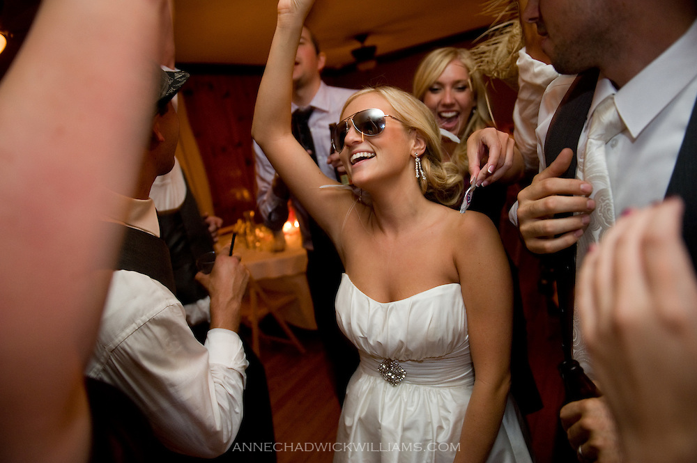 A bride dances at her wedding at Forest House Lodge in Foresthill, CA.