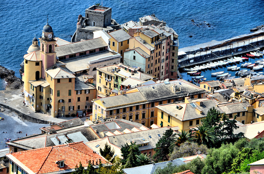 Santa Maria Assunta and Castello del Dragone in Camogli, Italy<br /> This delightful complex along the shore of the Italian Rivera in Camogli, Italy, has a significant history as well as beauty.  On the left is the Basilica of Santa Maria Assunta whose origin dates back to the 12th century.  On the right is Castello del Dragone, which was constructed as a fort in the 13th century.  It was frequently attacked but continuously rebuilt and enlarged each time.