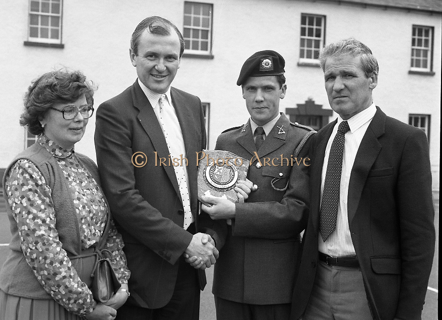 Army Apprentice Graduation Ceremony..1986..03.07.1986..07.03.1986..3rd July 1986..54 army apprentices graduated as tradesmen after completing three years of both military and technical training at the Army Apprentice School, Naas. The school is part of Devoy Military Barracks. The following trades are catered for: Radio Mechanic,Carpenter,Fitter, Electrician and Armourer..The newly graduated tradesmen will complete their basic military training at St Stephen's Barracks ,Kilkenny, for a further eight weeks..Mr John Witherington,Managing Director,Irish Shell, presented the awards...Picture of Mr John Witherington,Managing Director,Irish Shell,presenting Thomas Jennings with his award for best apprentice carpenter.His parents Pat and Mary Jennings,Seaman Drive,Riverside Estate,Galway are included in the picture.