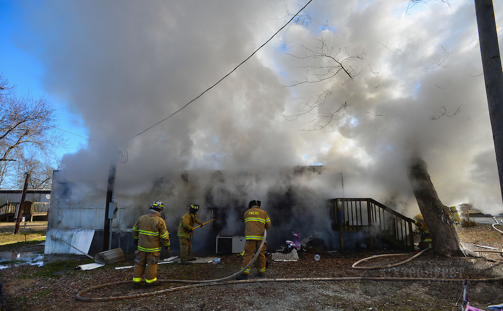 Gary Cosby Jr./Decatur Daily    A mobile home burns on Zehner Rd. in Limestone County east of Athens Tuesday.  Resident Jessica White said the fire started after the power, which had been turned off, was turned back on.  No one was injured in the blaze.  The temperature at the time of the fire was approximately 14 degrees.