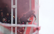 Picture by David Horn/Focus Images Ltd +44 7545 970036.23/02/2013.Crawley Town fans let off a flare during the npower League 1 match at the Matchroom Stadium, London.