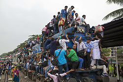 June 14, 2018 - Dhaka, Bangladesh - Bangladeshis cram onto a train as they travel back home to be with their families ahead of the Muslim festival of Eid al-Fitr in Dhaka , Bangladesh on June 14, 2018..Millions of city dwellers return home for Eid al-Fitr. (Credit Image: © Zakir Hossain Chowdhury via ZUMA Wire)