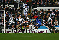 Photo: Andrew Unwin.<br /> Newcastle United v Chelsea. Carling Cup. 20/12/2006.<br /> Chelsea's Andriy Shevchenko (1 from R) takes a shot at goal.