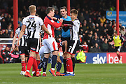 Crewe Alexandr's Lewis Reilly(24) and Grimsby Town midfielder Jake Hessenthaler(7) clash during the EFL Sky Bet League 2 match between Grimsby Town FC and Crewe Alexandra at Blundell Park, Grimsby, United Kingdom on 4 May 2019.