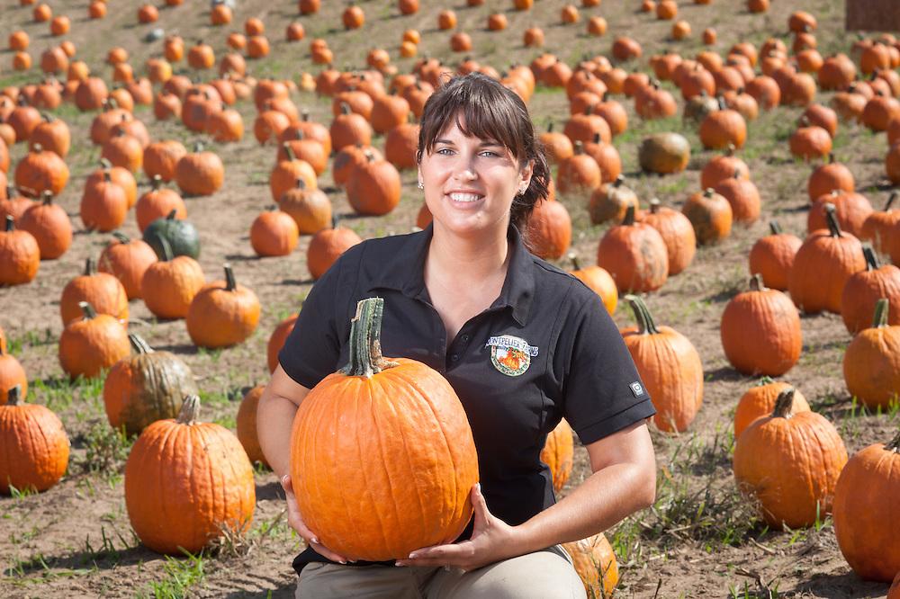 Woman holding pumpkin in pumpkin patch<br /> Upper Marlboro MD