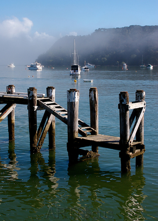 old steps at wharf on misty morning at Russell, Bay of Islands
