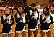 5 MARCH 2011 -- NORMANDY, Mo --  Cheerleaders from McCluer North High School pause during the National Anthem before the MSHSAA Class 5 boys basketball quarterfinals between the Stars and Chaminade College Prep at Mark Twain Hall on the University of Missouri - St. Louis campus in Normandy, Mo. Saturday, March 5, 2011. Image © copyright 2011 Sid Hastings.