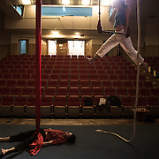 Maxime (on the left) and Sarah on the trapeze, doing some exercise before the show of Mobile Circus, in the Hebron theater