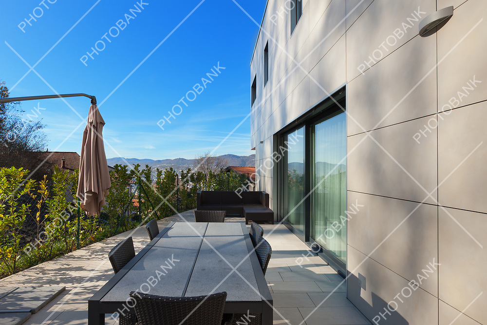 external of a modern house, patio with garden furniture