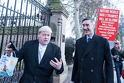 © Licensed to London News Pictures. 11/12/2018. LONDON, UK. Drew Galdron, a Boris Johnson look-alike, attempts to converse with Pro-Brexiteer Jacob Rees-Mogg, MP for North East Somerset, in Westminster. Theresa May, Prime Minister, is touring European capitals to try to renegotiate the Brexit agreement with the European Union after today's meaningful vote by MP's was deferred.  Photo credit: Stephen Chung/LNP