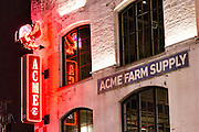 Neon sign for Acme Farm Supply restaurant on lower Broadway in Nashville, TN.