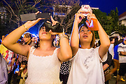 "30 JANUARY 2013 - PHNOM PENH, CAMBODIA:    Women use their smart phones to photograph the crematorium for late Cambodian King Norodom Sihanouk in Phnom Penh. Sihanouk (31 October 1922 - 15 October 2012) was the King of Cambodia from 1941 to 1955 and again from 1993 to 2004. He was the effective ruler of Cambodia from 1953 to 1970. After his second abdication in 2004, he was given the honorific of ""The King-Father of Cambodia."" Sihanouk held so many positions since 1941 that the Guinness Book of World Records identifies him as the politician who has served the world's greatest variety of political offices. These included two terms as king, two as sovereign prince, one as president, two as prime minister, as well as numerous positions as leader of various governments-in-exile. He served as puppet head of state for the Khmer Rouge government in 1975-1976. Most of these positions were only honorific, including the last position as constitutional king of Cambodia. Sihanouk's actual period of effective rule over Cambodia was from 9 November 1953, when Cambodia gained its independence from France, until 18 March 1970, when General Lon Nol and the National Assembly deposed him. Upon his final abdication, the Cambodian throne council appointed Norodom Sihamoni, one of Sihanouk's sons, as the new king. Sihanouk died in Beijing, China, where he was receiving medical care, on Oct. 15, 2012. His cremation is scheduled to take place on Feb. 4, 2013. Over a million people are expected to attend the service.        PHOTO BY JACK KURTZ"