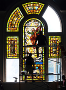 9/1/10 3WeWindow<br /> The First Congregational Church of Westbrook's west window was cleaned, releaded and the head, feet and hands of Jesus restored by Marsha Vasiloff Abrahamson, owner of Vasiloff Stained Glass of Old Lyme and Fabio Pizzol of Milan, Italy. The window was reinstalled in the church today. Among those installing it are Fabio Pizzol left, Bob Jean of Jean Mirror and Glass in Montville right and Wayne Abrahamson of Old Lyme bottom. Photo by Mara Lavitt
