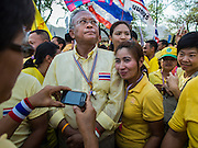 05 MAY 2104 - BANGKOK, THAILAND:  Anti-government leader SUTHEP THAUGSUBAN (center) poses for photos with anti-government protesters at Sanam Luang in Bangkok. Thousands of Thais packed the area around Sanam Luang and the Grand Palace Monday evening for a special ceremony to mark Coronation Day, which honored the 64th anniversary of the coronation of Bhumibol Adulyadej, the King of Thailand. Many of the people also support the anti-government movement led by Suthep Thaugsuban. Most of the anti-government protesters are conservative supporters of the monarchy.   PHOTO BY JACK KURTZ