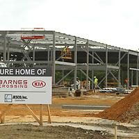 Work contunies at the home of the new Barnes Crossing Kia facility on Tom Watson Drive in Tupelo.