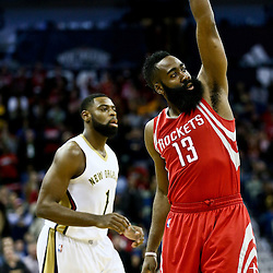 Jan 25, 2016; New Orleans, LA, USA; Houston Rockets guard James Harden (13) reacts after shooting against New Orleans Pelicans guard Tyreke Evans (1) during the first quarter of a game at the Smoothie King Center. Mandatory Credit: Derick E. Hingle-USA TODAY Sports