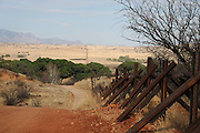 Holes have been cut in the fence at the Mexican border that divides Sonora with Lochiel, Arizona, USA, a former official port-of-entry.