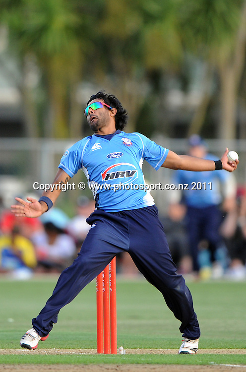 Auckland bowler Ronnie Hira in action during the HRV Twenty20 Cricket match between the Auckland Aces and Otago Volts at Colin Maiden Oval in Auckland, New Zealand on Friday 6 January 2012. Photo: Andrew Cornaga/Photosport.co.nz