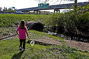 Taytiana walks down to the creek to catch crawdads, frogs and other creatures. The creek runs beside the trailer park in Granville where she lives and has become one of her favorite places to play with her family. This is the first real home Taytiana has known, having had to move around from place to place for the past few years. Her mother, Genesis, is worried how the forced move will affect her children, now that they have finally been able to call this place home.