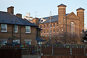 The perimiter wall of HMP Wormwood Scrubs adjacent to houses.