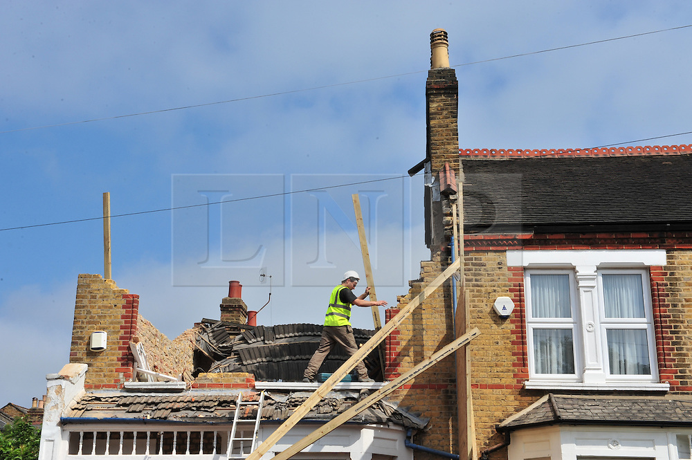 &copy; Licensed to London News Pictures. 09/06/2016<br /> Lewisham collapsed house clean up begins.<br /> Builders have started clearing work on the terrace house in Lampmead Road,Lewisham that dramatically collapsed yesterday (08/06/16). <br /> <br /> <br /> <br /> (Byline:Grant Falvey/LNP)