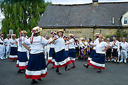 England's Glory Ladies Morris dancers perform a dancing display at The Kings Head Pub in Bledington, Oxfordshire, UK