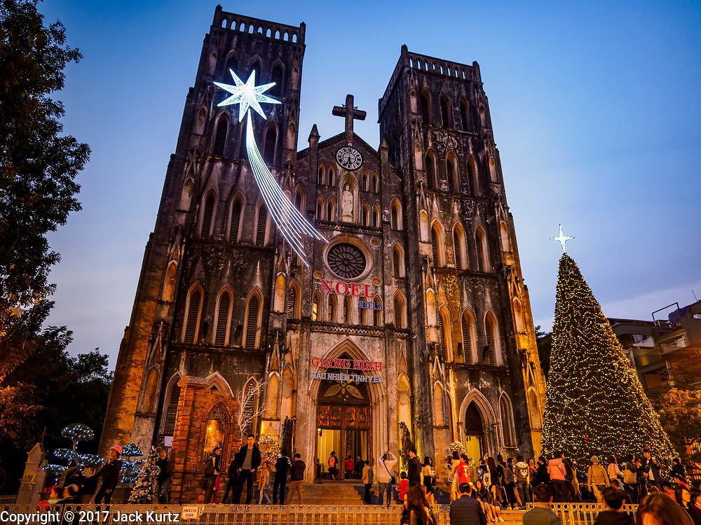 25 DECEMBER 2017 - HANOI, VIETNAM: St Joseph's Cathedral lit up for the Christmas holidays in Hanoi.     PHOTO BY JACK KURTZ