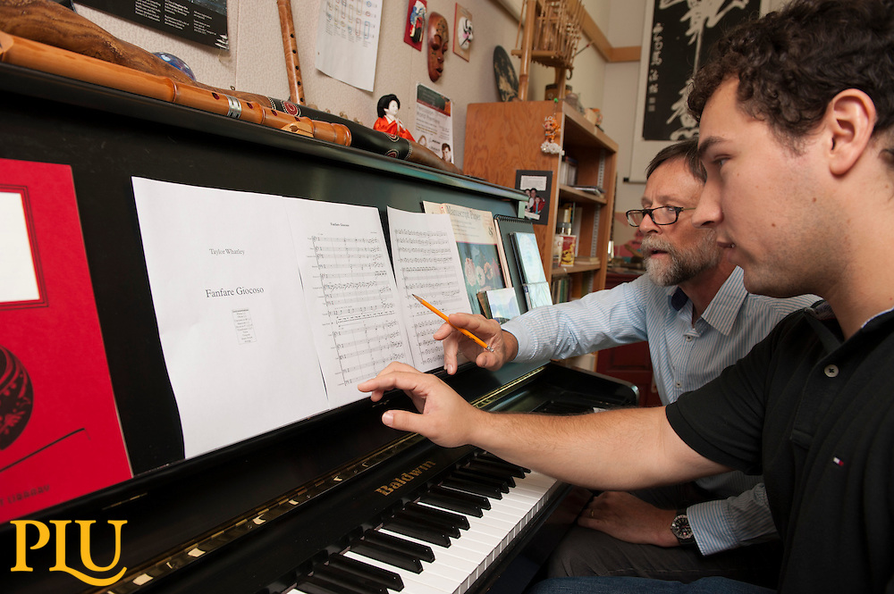 Taylor Whatley works with Prof. Greg Youtz in Mary Baker Russell Music Center at PLU on Monday, Oct. 6, 2014. (Photo/John Struzenberg)