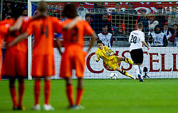 Nick Olij of Netherlands and Marc Stendera of Germany during penalty shots during the UEFA European Under-17 Championship Final match between Germany and Netherlands on May 16, 2012 in SRC Stozice, Ljubljana, Slovenia. Netherlands defeated Germany after penalty shots and became European Under-17 Champion 2012. (Photo by Vid Ponikvar / Sportida.com)