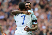 Jermain Defoe of England hugging Raheem Sterling of England after scoring 1-0 during the FIFA World Cup Qualifier group stage match between England and Lithuania at Wembley Stadium, London, England on 26 March 2017. Photo by Matthew Redman.