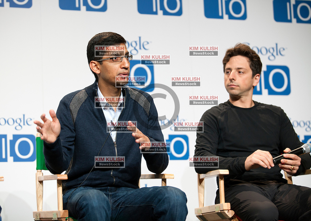 Sundar Pichai, Sr VP at Google ,(L) and Sergey Brin, co-founder of Google Inc., attends a press conference on the new Google Chomebook at the Google I/O developer's conference in San Francisco, California.