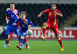 SWANSEA, WALES - Tuesday, March 26, 2013: Wales' Ashley Williams in action against Croatia's Luka Modric during the 2014 FIFA World Cup Brazil Qualifying Group A match at the Liberty Stadium. (Pic by Kieran McManus/Propaganda)