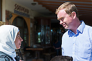 Tim Farron MP, leader of the UK Liberal Democrat Party, speaks to Manar Aeid, a Syrian refugee in northern Greece.