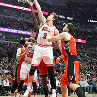 24 March 2012: Chicago Bulls center Omer Asik (3) reaches for the rebound during the Chicago Bulls 102-101 victory in overtime over the Toronto Raptors at the United Center, Chicago, Illinois, USA.